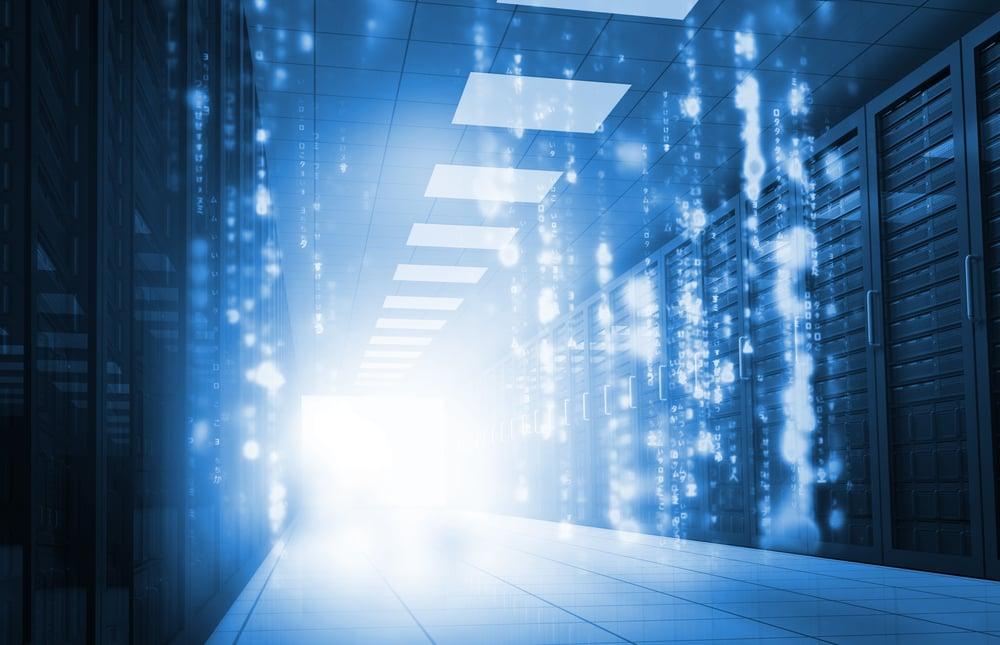 Glowing blue matrix falling in data center